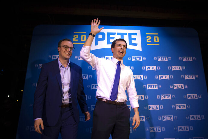 Democratic presidential candidate Pete Buttigieg, right, and husband, Chasten Glezman, acknowledge supporters after speaking at a campaign event, Thursday, May 9, 2019, in West Hollywood, Calif. (AP Photo/Jae C. Hong)