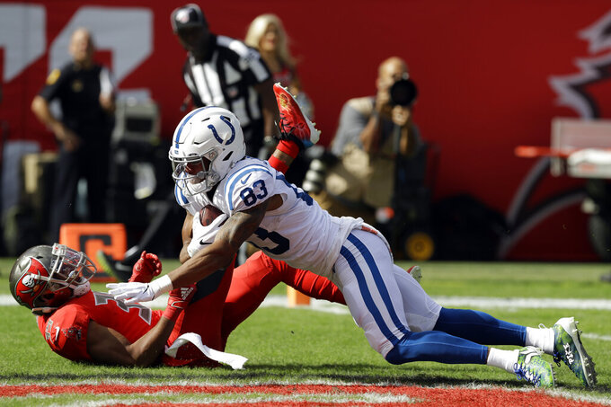Indianapolis Colts wide receiver Marcus Johnson (83) beats Tampa Bay Buccaneers strong safety Andrew Adams (39) on a 46-yard touchdown reception during the first half of an NFL football game Sunday, Dec. 8, 2019, in Tampa, Fla. (AP Photo/Chris O'Meara)