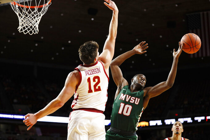 Mississippi Valley State guard Ahmadu Sarnor (10) fights for a rebound with Iowa State forward Michael Jacobson (12) during the second half of an NCAA college basketball game, Tuesday, Nov. 5, 2019, in Ames, Iowa. (AP Photo/Charlie Neibergall)