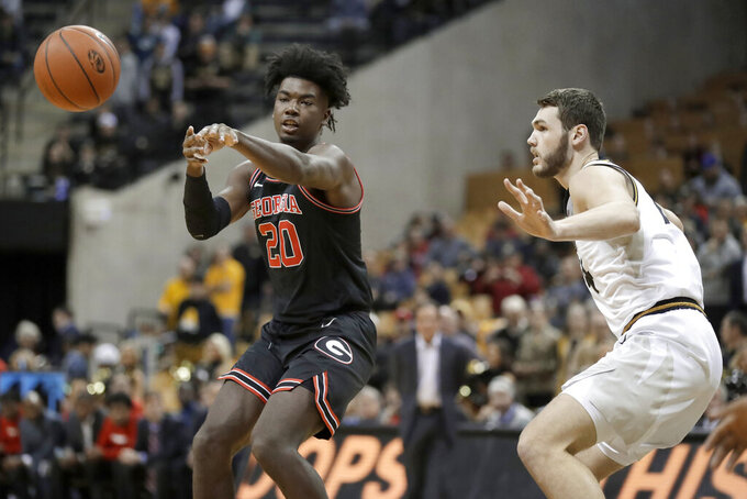 Georgia's Rayshaun Hammonds (20) passes the ball as Missouri's Reed Nikko defends during the first half of an NCAA college basketball game Tuesday, Jan. 28, 2020, in Columbia, Mo. (AP Photo/Jeff Roberson)