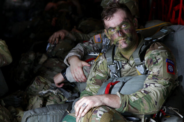 In this Jan. 26, 2020, photo, Sgt. Micah Jurekovic waits for takeoff inside a C-130 Hercules transport plane, with dozens of other 82nd Airborne Division paratroopers, to jump into Melgar, Colombia, alongside their South American counterparts during a training exercise. (AP photo/Sarah Blake Morgan)