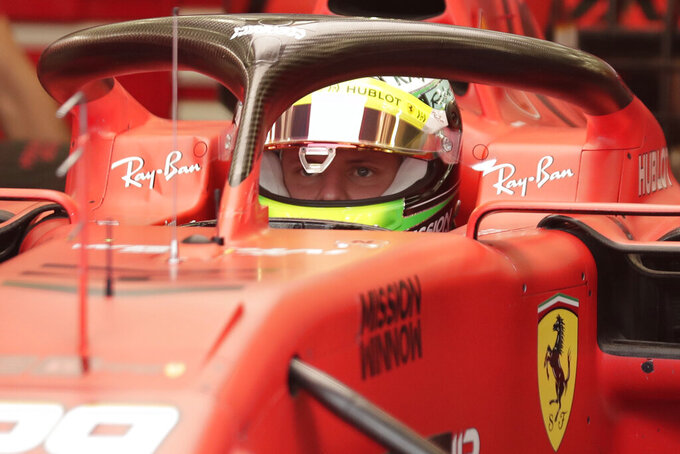 Mick Schumacher prepares for his first F1 test for Ferrari at the Bahrain International Circuit in Sakhir, Bahrain, Tuesday, April 2, 2019. Mick Schumacher has moved closer to emulating his father Michael by driving a Ferrari Formula One car in an official test. Schumacher's father won seven F1 titles, five of those with Ferrari and holds the record for race wins with 91. (AP Photo/Hassan Ammar)