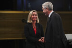 European Union Foreign Policy chief Federica Mogherini, left, shakes hands with UN High Commissioner for Refugees Filipo Grandi at the end of a joint news conference at the EU headquarters in Brussels, Tuesday, Oct. 29, 2019. The European Union says a