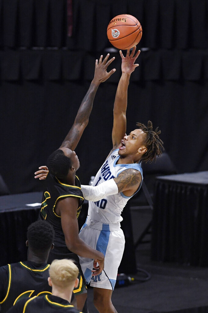Rhode Island's Fatts Russell, right, shoots over San Francisco's Jamaree Bouyea, left, in the first half of an NCAA college basketball game, Sunday, Nov. 29, 2020, in Uncasville, Conn. (AP Photo/Jessica Hill)