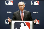 FILE - In this Nov. 21, 2019, file photo, baseball commissioner Rob Manfred speaks to the media at the owners meeting in Arlington, Texas. The chance that there will be no Major League Baseball season increased substantially Monday, June 15, 2020, when the commissioner's office told the players' association it will not proceed with a schedule amid the coronavirus pandemic unless the union waives its right to claim management violated a March agreement between the feuding sides. (AP Photo/LM Otero, File)