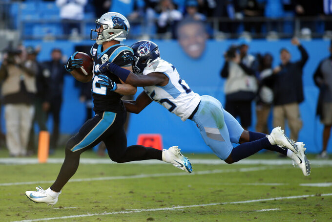 Carolina Panthers running back Christian McCaffrey runs for a touchdown while Tennessee Titans cornerback Adoree' Jackson tackles during the second half of an NFL football game in Charlotte, N.C., Sunday, Nov. 3, 2019. (AP Photo/Brian Blanco)