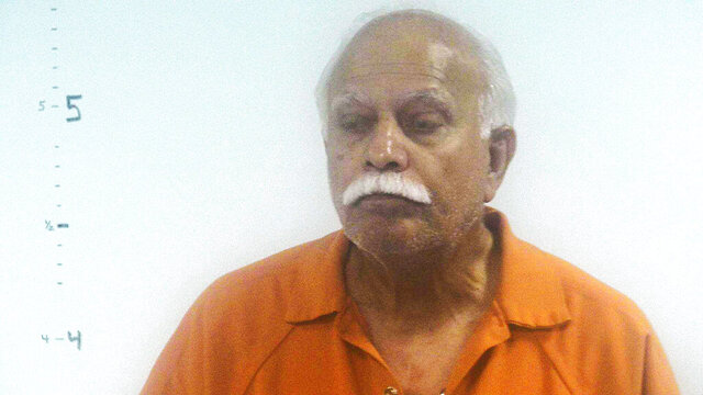 FILE - This undated file photo provided by Western Tidewater Regional Jail, in Virginia, shows Dr. Javaid Perwaiz. On Monday, Nov. 9, 2020, the Justice Department said that a federal jury convicted Perwaiz of submitting false insurance claims after performing what authorities described as unnecessary surgeries on women. (Western Tidewater Regional Jail via AP, File)