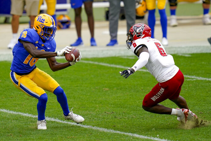 Pittsburgh Panthers wide receiver Shocky Jacques-Louis (18) makes a catch in front of North Carolina State safety Jakeen Harris (6) in the first half of an NCAA college football game, Saturday, Oct. 3, 2020, in Pittsburgh. (AP Photo/Keith Srakocic)