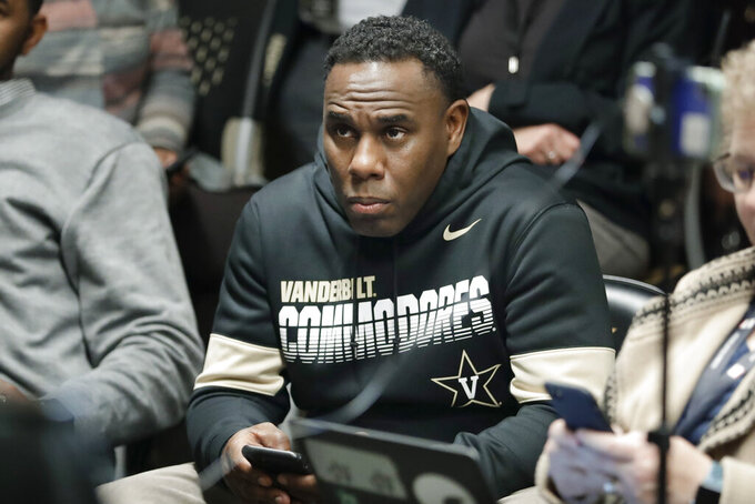 FILE - In this Feb. 5, 2020, file photo,, Vanderbilt football coach Derek Mason listens as interim athletic director Candice Lee answers questions during a news conference in Nashville, Tenn. Vanderbilt athletic director Candice Lee said Monday that Vanderbilt has an opportunity to put its money where its mouth is and prove its commitment to football as they search for a new football coach to replace Derek Mason, who was fired Sunday.(AP Photo/Mark Humphrey, Fiole)