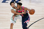 Washington Wizards' Troy Brown Jr. (6) brings the ball down the court as Boston Celtics' Tremont Waters defends during the second half of an NBA basketball game Thursday, Aug. 13, 2020 in Lake Buena Vista, Fla. (AP Photo/Ashley Landis, Pool)