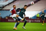 Leeds United's Rodrigo, right, heads the ball in front of Aston Villa's Douglas Luiz, during the English Premier League soccer match between Aston Villa and Leeds United at Villa Park in Birmingham, England, Friday, Oct. 23, 2020. (Michael Steele/Pool via AP)