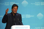 Pakistan's Prime Minister Imran Khan gestures while speaking during the World Government Summit in Dubai, United Arab Emirates, Sunday, Feb. 10, 2019. Khan on Sunday met with the head of the International Monetary Fund and later told a crowd that Pakistan needed