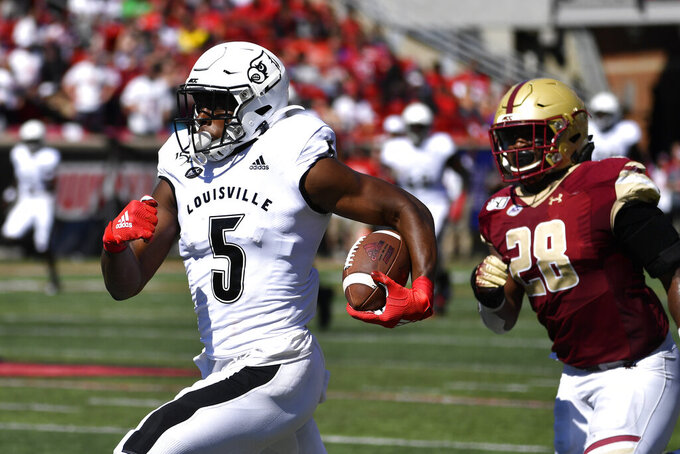 Louisville wide receiver Seth Dawkins (5) attempts to outrun the pursuit of Boston College linebacker John Lamot (28) during the first half of an NCAA college football game in Louisville, Ky., Saturday, Oct. 5, 2019. (AP Photo/Timothy D. Easley)