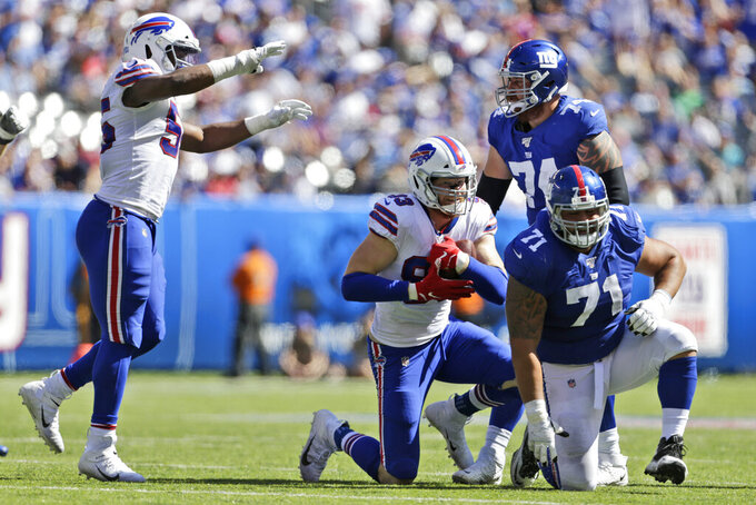 Buffalo Bills' Trent Murphy, second from left, reacts after an interception during the first half of an NFL football game against the New York Giants, Sunday, Sept. 15, 2019, in East Rutherford, N.J. (AP Photo/Adam Hunger)