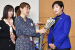 Tokyo Governor Yuriko Koike, right, speaks to reporters after a meeting with the International Olympic Committee officials in Tokyo Wednesday, Oct. 30, 2019.  Tokyo Governor Koike has told powerful IOC members she wants the Olympic marathon held in Tokyo and lashed out at what she called an