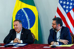 U.S. Secretary of State Mike Pompeo speaks as Brazilian Foreign Minister Ernesto Araujo looks on during a press conference at the Boa Vista Air Base in Roraima, Brazil, Friday, Sept. 18, 2020. The stop in Brazil is part of Pompeo's three-day visit of his South American tour. (Bruno Mancinelle/Pool via AP)