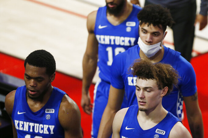 Kentucky players leaves the court after a loss to Georgia in an NCAA college basketball game Wednesday, Jan. 20, 2021, in Athens, Ga. (Joshua L. Jones/Athens Banner-Herald via AP)