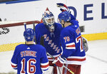 New York Rangers goaltender Henrik Lundqvist celebrates with Brady Skjei (76) and Ryan Strome (16) after the Rangers defeated the New Jersey Devils 4-2 in an NHL hockey game Saturday, March 9, 2019, at Madison Square Garden in New York (AP Photo/Bill Kostroun)