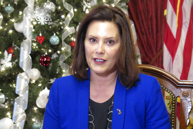 FILE - In this Dec. 18, 2019, file photo, Michigan Gov. Gretchen Whitmer speaks at the Capitol in Lansing, Mich. Whitmer says Facebook CEO Mark Zuckerberg should do more to curb hate speech on the platform, days after a political page was shut down over racist, misogynistic posts advocating violence against Muslims and female Democrats. Whitmer went on social media Friday, Jan. 17, 2020, to post a letter to Zuckerberg in which she referenced the posts on Facebook. The creator of the anti-Whiter group deactivated it after the Metro Times in Detroit began asking questions. The publication identified dozens of posts promoting or threatening violence against Whitmer and others. A message seeking comment was left with Facebook. (AP Photo/David Eggert, File)