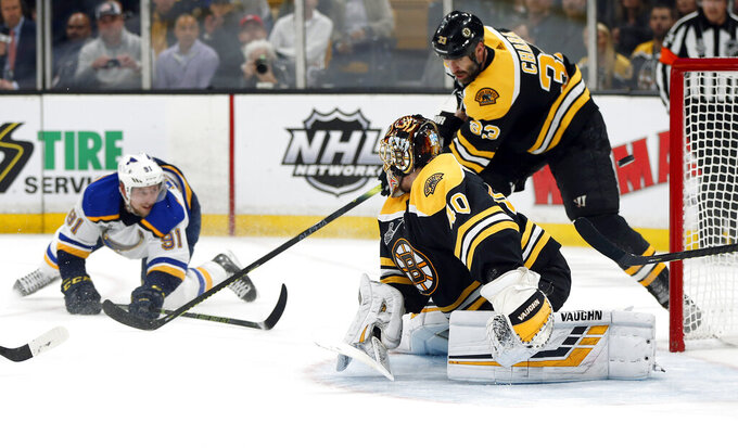 St. Louis Blues' Vladimir Tarasenko, left, of Russia, watches his shot sail puck past Boston Bruins goaltender Tuukka Rask, front, of Finland, and Zdeno Chara (33), of Slovakia, for a goal during the first period in Game 2 of the NHL hockey Stanley Cup Final, Wednesday, May 29, 2019, in Boston. (AP Photo/Michael Dwyer)