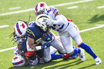 Los Angeles Chargers running back Austin Ekeler (30) is tackled on the run by Buffalo Bills strong safety Micah Hyde (23) during the first half of an NFL football game, Sunday, Nov. 29, 2020, in Orchard Park, N.Y. (AP Photo/Adrian Kraus)