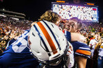 Auburn tight end Phelps Gambill (89) celebrates with a fan after the team defeated Alabama 48-45 in an NCAA college football game, Saturday, Nov. 30, 2019, in Auburn, Ala. (Dan Busey/The Decatur Daily via AP)