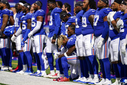 New York Giants safety Xavier McKinney (29) kneels during the playing of the national anthem before an NFL football game against the Atlanta Falcons, Sunday, Sept. 26, 2021, in East Rutherford, N.J. (AP Photo/Seth Wenig)