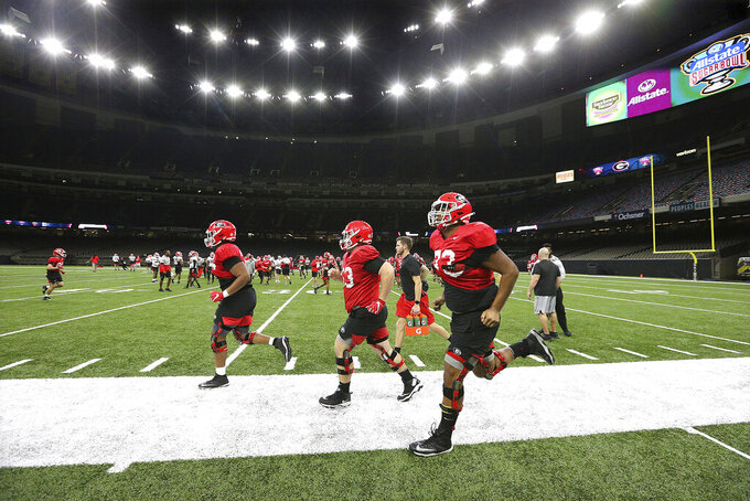 Georgia players take the field during team practice for the Sugar Bowl NCAA college football game against Baylor, Sunday, Dec. 29, 2019, in New Orleans. The game is to be played Wednesday, Jan. 1, 2020. (Curtis Compton/Atlanta Journal-Constitution via AP)