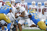 Stanford running back Austin Jones (20) is tackled by UCLA defensive back Qwuantrezz Knight (24) during the first half of an NCAA college football game Saturday, Dec. 19, 2020, in Pasadena, Calif. (AP Photo/Ringo H.W. Chiu)
