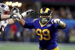 FILE - In this Feb. 3, 2019, file photo, Los Angeles Rams Aaron Donald (99) rushes against the New England Patriots during NFL Super Bowl 53 in Atlanta. Donald is participating in his first training camp since 2016 after holding out for the past two summers in search of a new contract. (AP Photo/Gregory Payan, File)