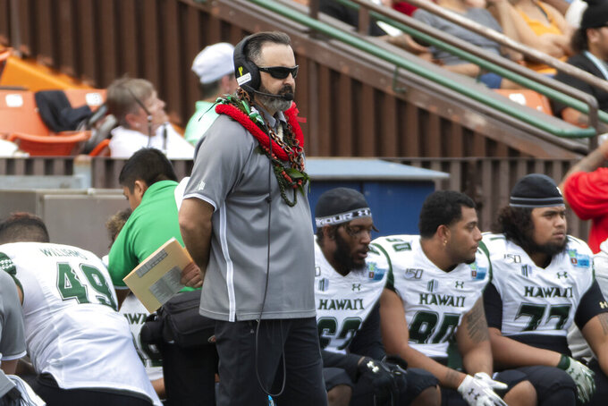 Hawaii coach Nick Rolovich watches during the first half of the team's Hawaii Bowl NCAA college football game against BYU, Tuesday, Dec. 24, 2019, in Honolulu. (AP Photo/Eugene Tanner)