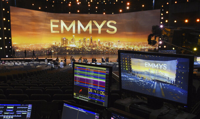 FILE - A video monitor displays the stage for Sunday's 71st Primetime Emmy Awards during Press Preview Day in Los Angeles on Sept. 19, 2019. The Emmy Awards will be held on Sept. 19 and air live on CBS. (Photo by Chris Pizzello/Invision/AP, File)