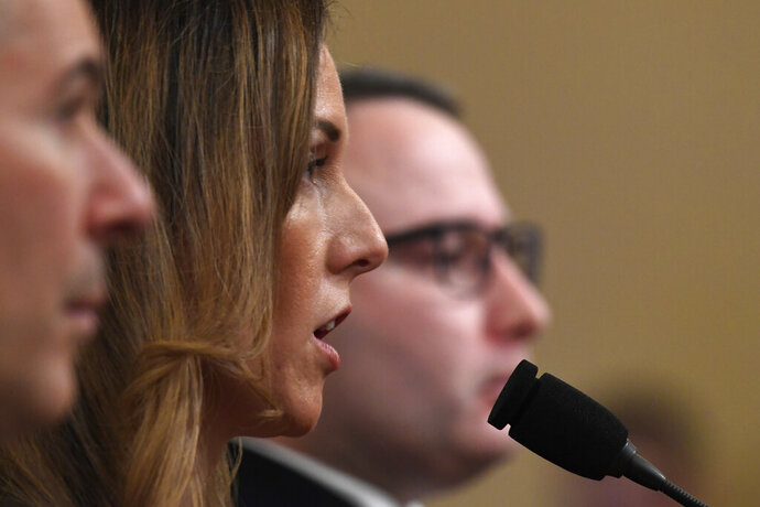 Jennifer Williams, an aide to Vice President Mike Pence, center, and National Security Council aide Lt. Col. Alexander Vindman, testify before the House Intelligence Committee on Capitol Hill in Washington, Tuesday, Nov. 19, 2019, during a public impeachment hearing of President Donald Trump's efforts to tie U.S. aid for Ukraine to investigations of his political opponents. (AP Photo/Susan Walsh)