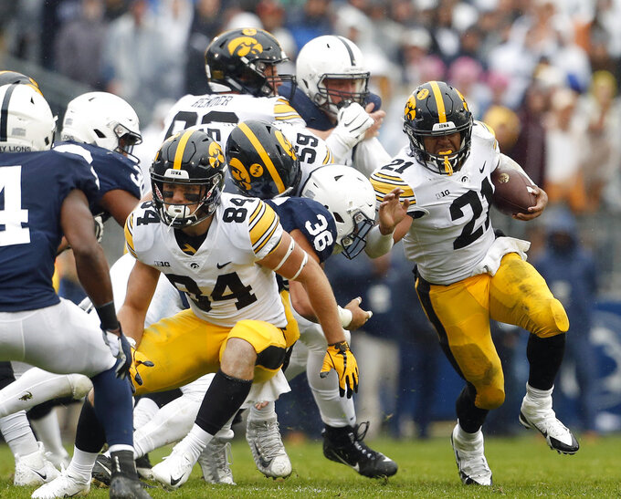 Iowa's Ivory Kelly-Martin (21) runs the ball against Penn State during the first half of an NCAA college football game in State College, Pa., Saturday, Oct. 27, 2018. (AP Photo/Chris Knight)