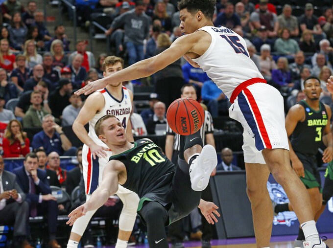 Gonzaga forward Brandon Clarke (15) defends against Baylor guard Makai Mason (10) during the first half of a second-round game in the NCAA men's college basketball tournament Saturday, March 23, 2019, in Salt Lake City. (AP Photo/Rick Bowmer)