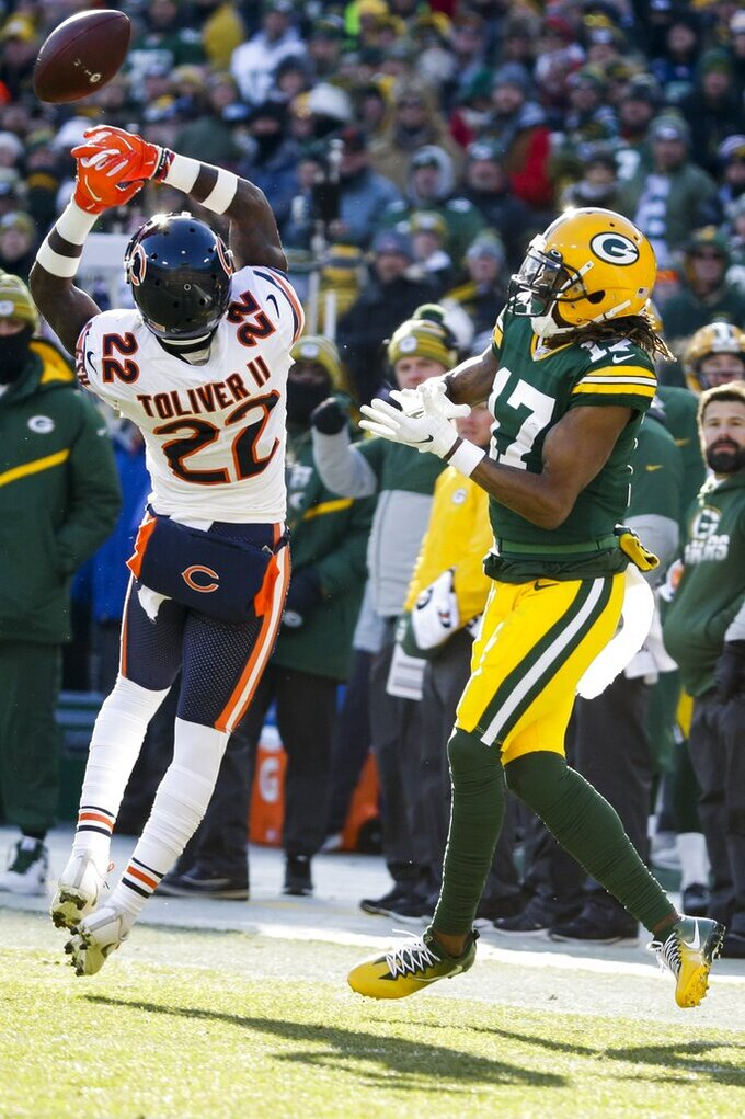 Chicago Bears' Kevin Toliver II breaks up a pass intended for Green Bay Packers' Davante Adams during the first half of an NFL football game Sunday, Dec. 15, 2019, in Green Bay, Wis. (AP Photo/Mike Roemer)