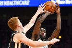 Brooklyn Nets forward Taurean Prince shoots as Atlanta Hawks guard Kevin Huerter, left, defends during the first half of an NBA basketball game Wednesday, Dec. 4, 2019, in Atlanta. (AP Photo/John Amis)