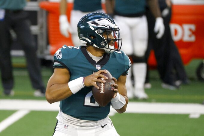 Philadelphia Eagles quarterback Jalen Hurts looks to throw a pass in the first half of an NFL football game against the Dallas Cowboys in Arlington, Texas, Sunday, Dec. 27. 2020. (AP Photo/Ron Jenkins)