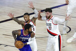 Los Angeles Clippers guard Paul George (13) looks to pass as Portland Trail Blazers guard Damian Lillard (0) and center Jusuf Nurkic (27) defend during the second half in an NBA basketball game Saturday, Aug. 8, 2020, in Lake Buena Vista, Fla. (Kim Klement/Pool Photo via AP)