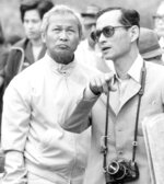 FILE - In this Feb. 16, 1981 file photo, Thailand's King Bhumibol, right, talks with then Prime Minister Prem Tinsulanonda during their visit to an irrigation project in northern Thailand. Prem Tinsulanonda, one of Thailand's most influential political figures over four decades who served as army commander, prime minister and adviser to the royal palace, has died at age 98. Thai media reported he died Sunday morning, May 26, 2019,  in a Bangkok hospital, and an official announcement is expected. (AP Photo/Jeff Robbins, File)
