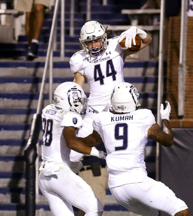 Old Dominion running back Matt Geiger (44) celebrates a touchdown with teammates Eric Kumah (9) and Blake Watson (28) during the second quarter of an NCAA college football game against Virginia in Charlottesville, Va., Saturday, Sept. 21, 2019. (AP Photo/Andrew Shurtleff)
