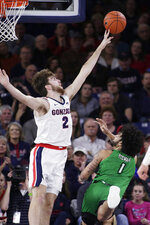 North Dakota guard Marlon Stewart (1) shoots and draws a foul on Gonzaga forward Drew Timme (2) during the first half of an NCAA college basketball game in Spokane, Wash., Tuesday, Nov. 12, 2019. (AP Photo/Young Kwak)