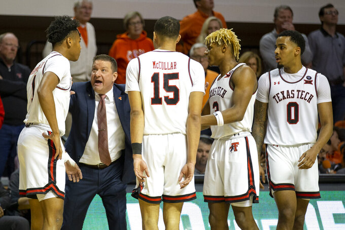 Texas Tech head coach Chris Beard talks with his team during an NCAA college basketball game against Oklahoma State in Stillwater, Okla., Saturday, Feb. 15, 2020. (AP Photo/Mitch Alcala)