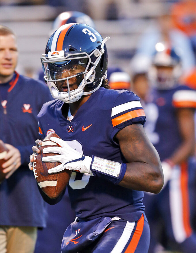 FILE - In this Saturday Oct. 13, 2018, file photo, Virginia quarterback Bryce Perkins (3) warms up prior to the start of the Miami-Virginia NCAA college football game in Charlottesville, Va. (AP Photo/Steve Helber, File)