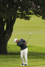 Brooks Koepka hits from the fairway on the 14th hole during the third round of the U.S. Open golf tournament Saturday, June 15, 2019, in Pebble Beach, Calif. (AP Photo/Carolyn Kaster)