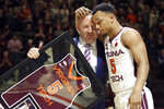 Virginia Tech coach Buzz Williams and senior guard Justin Robinson (5) hug during a ceremony honoring the team seniors, before the team's NCAA basketball game against Miami in Blacksburg, Va., Friday, March 8, 2019. (Matt Gentry/The Roanoke Times via AP)