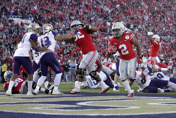 Ohio State running back J.K. Dobbins scores against Washington during the second half of the Rose Bowl NCAA college football game Tuesday, Jan. 1, 2019, in Pasadena, Calif. (AP Photo/Jae C. Hong)