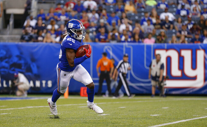 New York Giants defensive back Corey Ballentine (25) runs the ball on the kickoff against the Chicago Bears during the first quarter of a pre-season NFL football game, Friday, Aug. 16, 2019, in East Rutherford, N.J. (AP Photo/Adam Hunger)