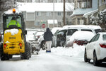 A vehicle is stuck in the snow on Murray Hill Avenue in Springfield's Liberty Heights neighborhood after an overnight snowstorm, Monday, Dec. 2, 2019, in Springfield, Mass. (Don Treeger/The Republican via AP)