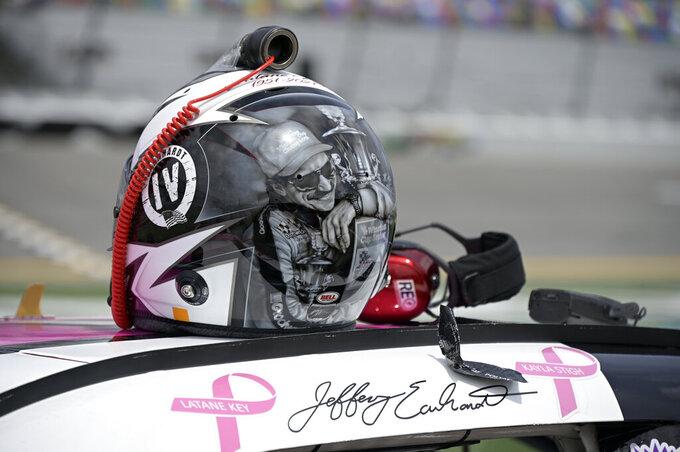 Jeffrey Earnhardt's helmet, bearing the likeness of his grandfather Dale Earnhardt, sits on top of his car before the restart of a NASCAR Xfinity Series auto race at Daytona International Speedway, Saturday, Aug. 28, 2021, in Daytona Beach, Fla. (AP Photo/Phelan M. Ebenhack)